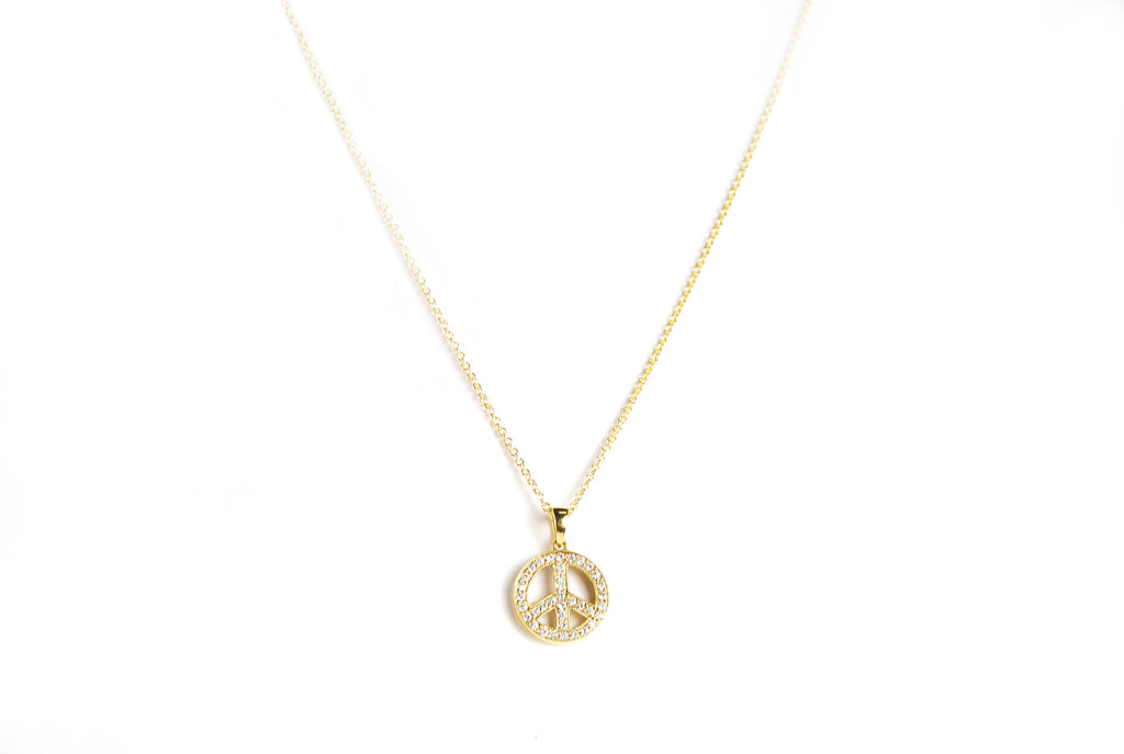 Diamond peace sign necklace set in 14k yellow gold