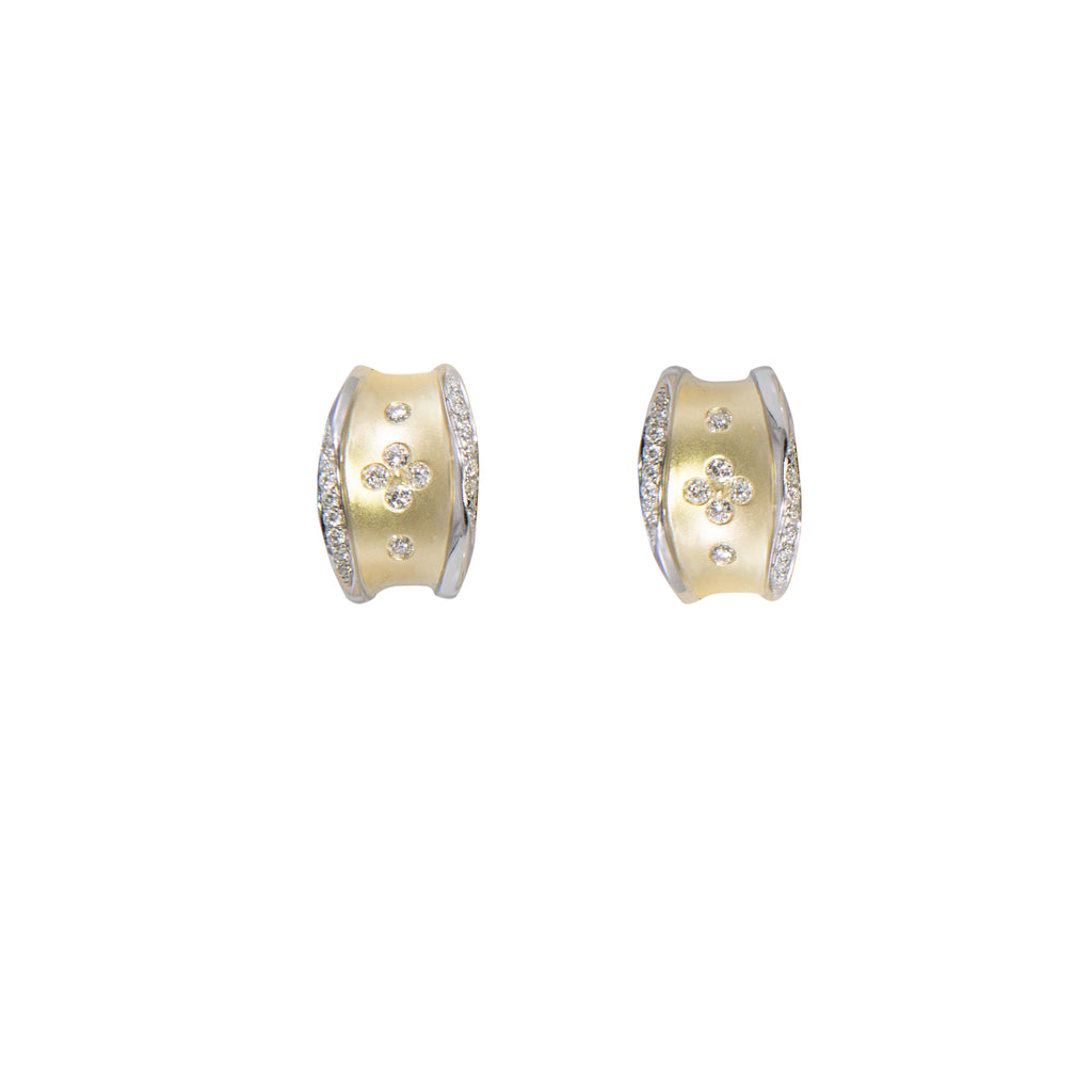14k yellow gold matte finish with round diamonds 0.43 cts. 15 mm x 10 mm. Heavy weight friction backs.