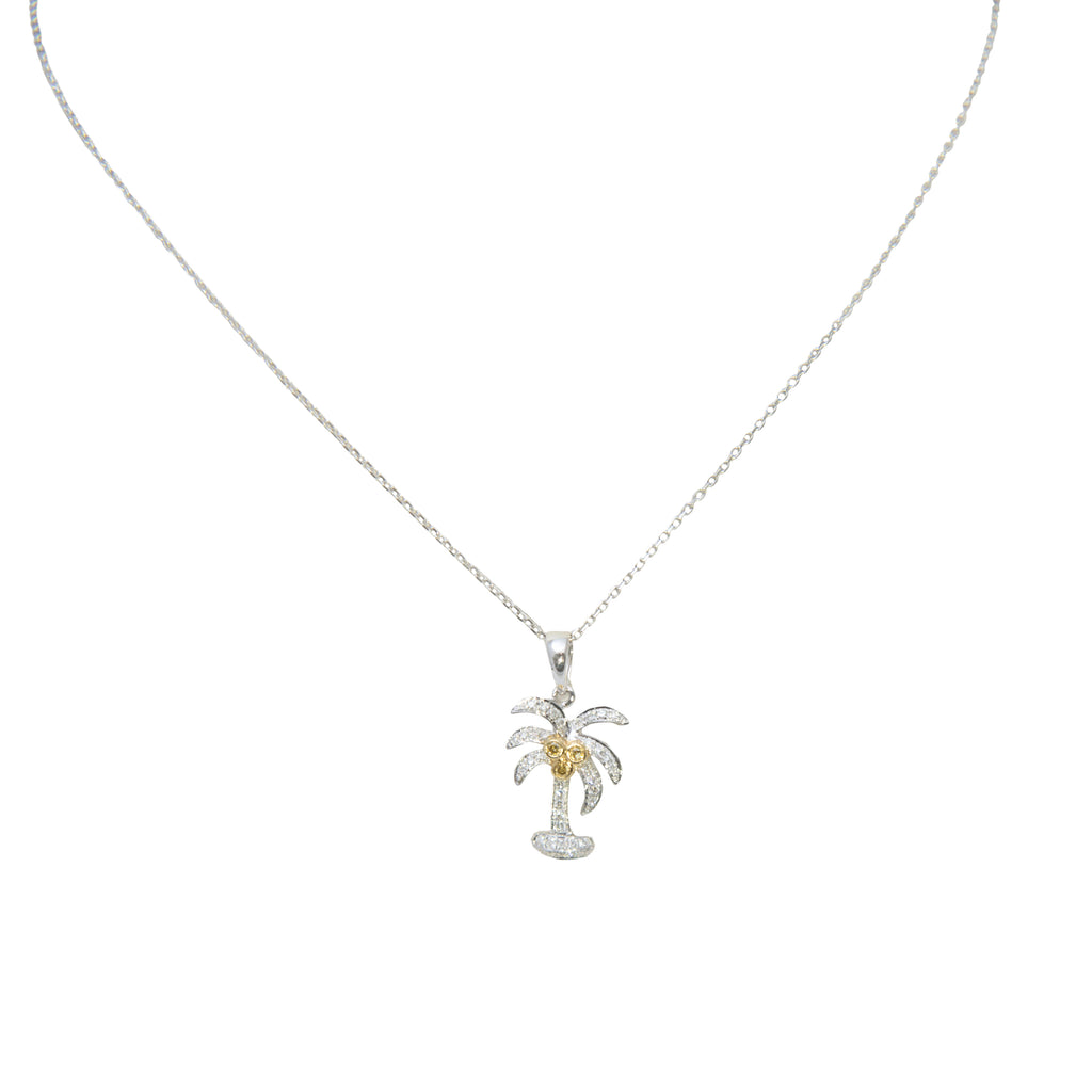 "18k white gold palm tree pendant with 38 round diamonds 0.15 cts and three yellow diamonds 0.03 cts. 14k white gold chain sold separately 18"" length $205.00"