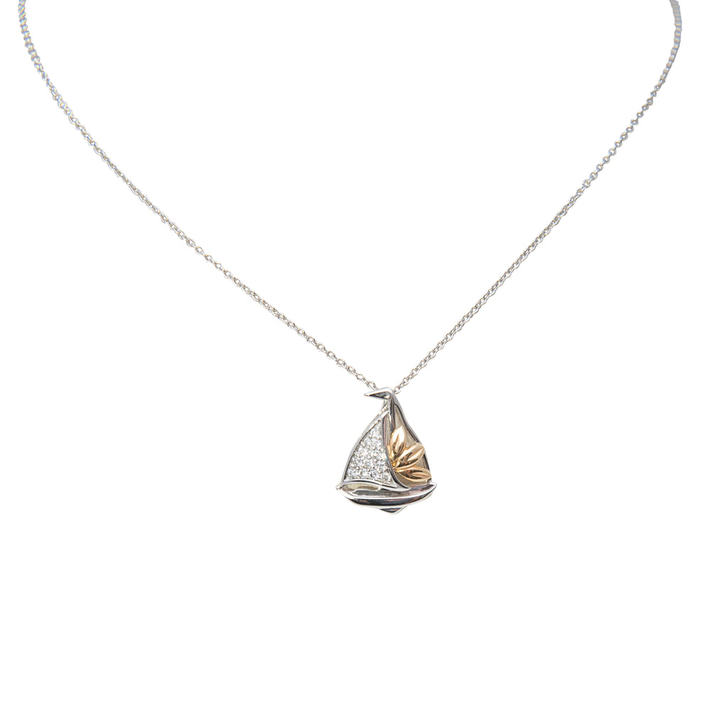 "14k white & yellow gold sailboat necklace. 1/2"" x 1/2"". round diamonds 0.15 cts  18"" white gold chain is optional $205.00"