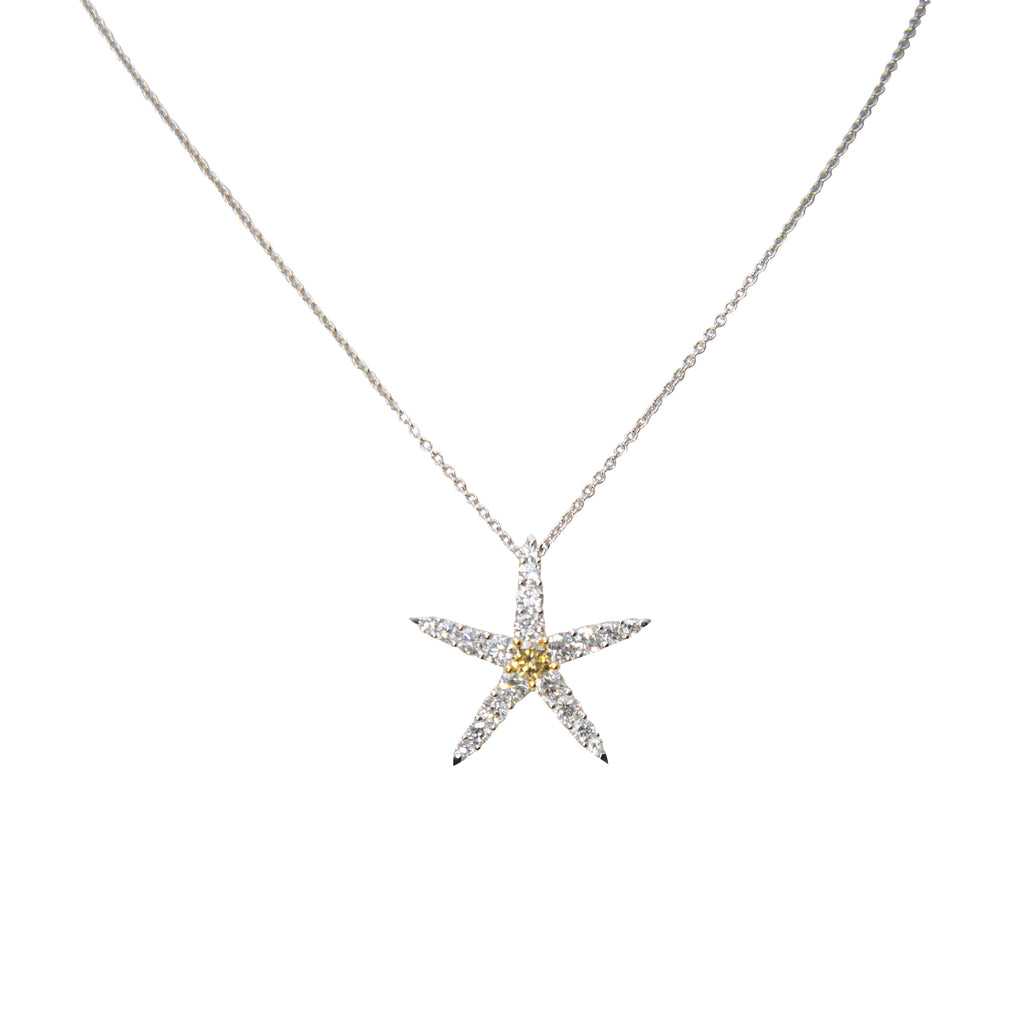 "18k white gold starfish pendant, round diamonds 1.17 cts & one yellow diamond 0.23 cts , lobster clasp, hidden bail, 23.50 mm. 18"" white gold 1.5 mm chain is optional $280"