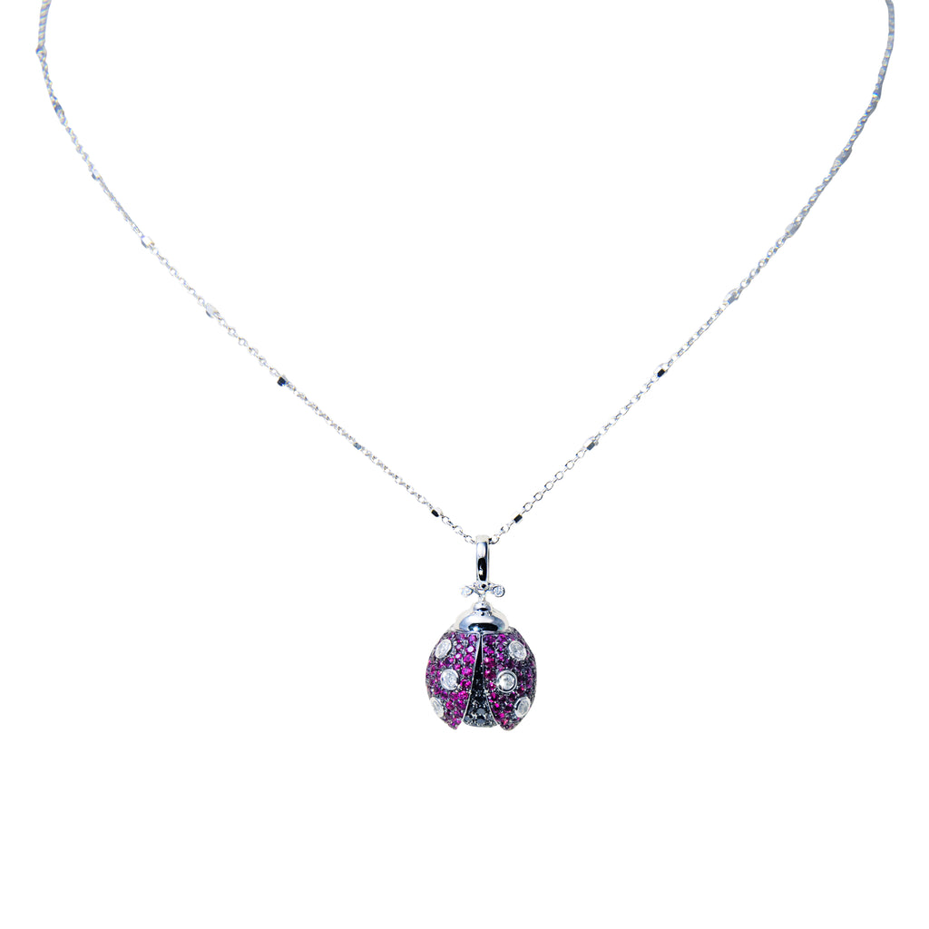 "18k white gold ladybug pendant, black & white diamond 0.77 cts and rubies 0.71 cts, special bail, gallery design at the back, lobster clasp, 3D pendant (9mm thickness) 12 mm long. 16"" white gold chain optional $220.00"