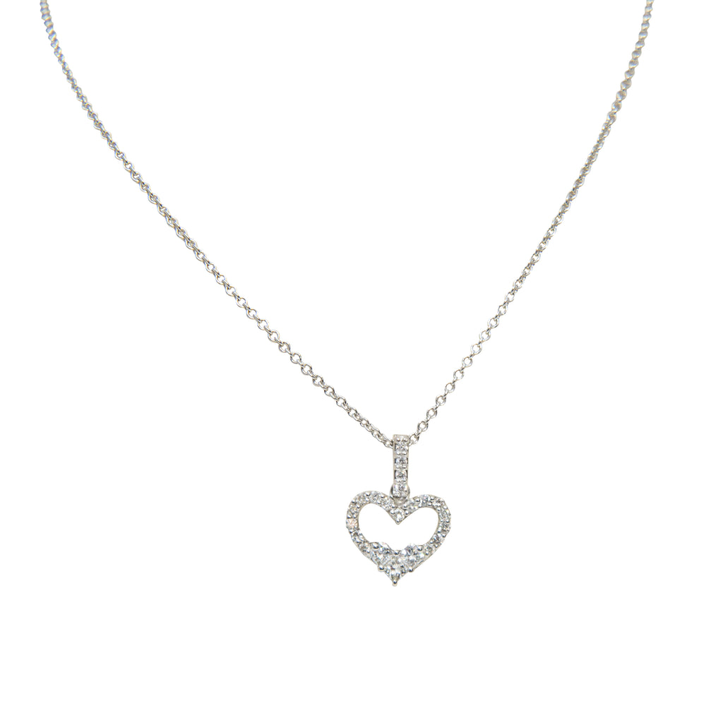 "18k white gold cut out  heart shape pendant, round diamonds 0.40 cts, lobster clasp, diamond bail, 8.56 mm (without bail), small heart shape at the bottom of pendant. 18"" white gold chain."
