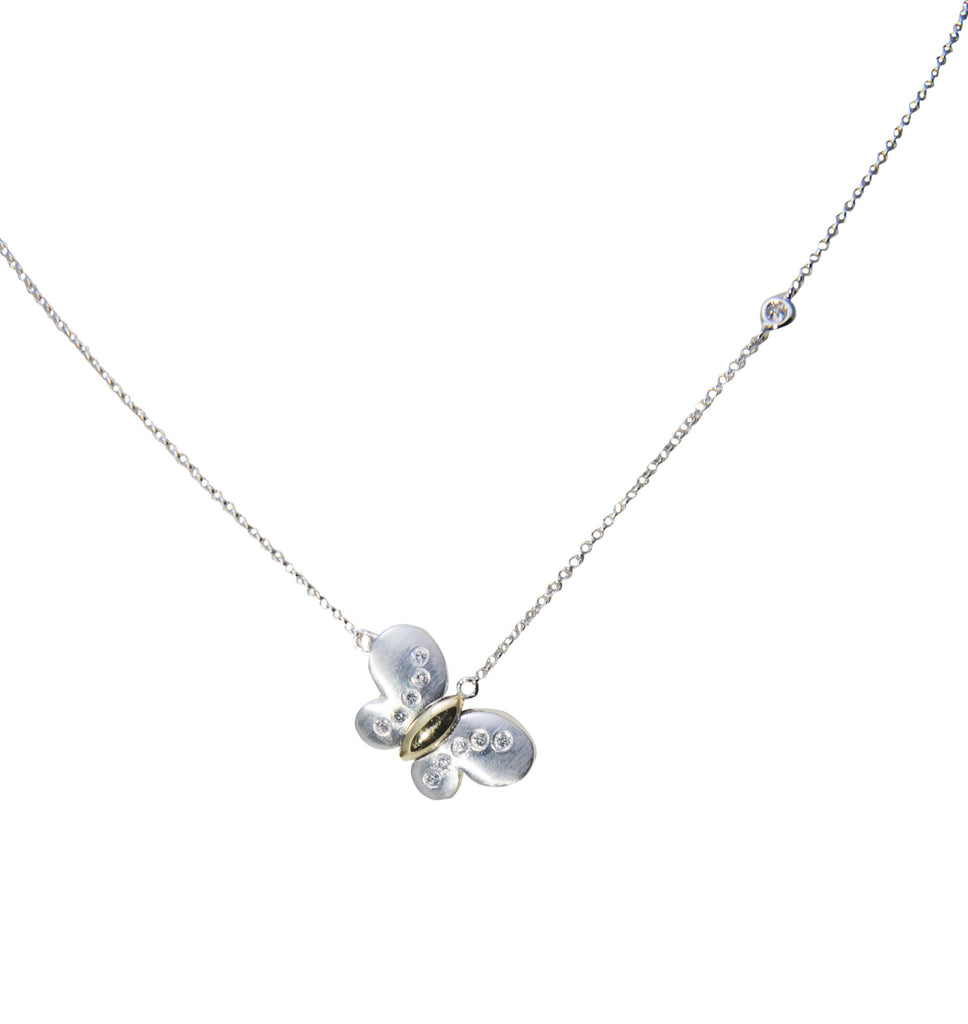 Matte finish, white and yellow gold butterfly with diamonds on a white gold chain. 11 diamonds 0.13 cts, 14kt white gold