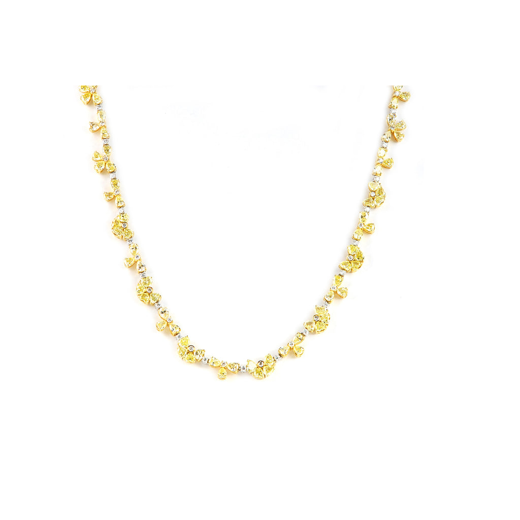"Stunning yellow diamond flower shape necklace.  Set in 18k yellow & white gold.  112 pear shape fancy yellow diamonds 23.26 cts  64 round white diamonds 2.10 cts   Secure clasp with figure 8 for safety  17"" long"