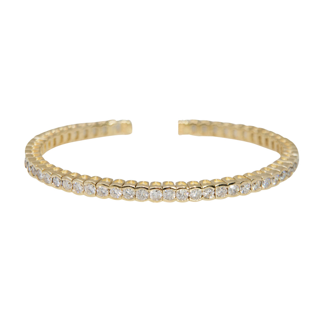 14k yellow gold cuff, flexible and study cuff, 55 white round diamonds 4.25 cts. 3.77 mm width, inner diameter 55.50 x 44.60 mm