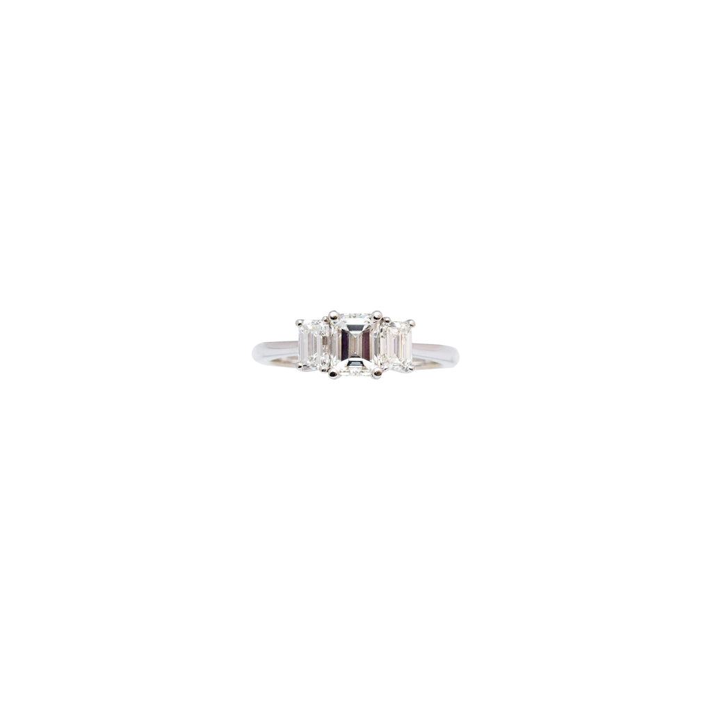 This is a gorgeous custom made engagement ring. Three stone ring symbolizes the past, present and future with your partner. Set in a platinum mounting. Size 6.75 (sizable). One emerald cut center stone Color I Clarity VS2 1.01cts Two side emerald cut stones  0.80 cts