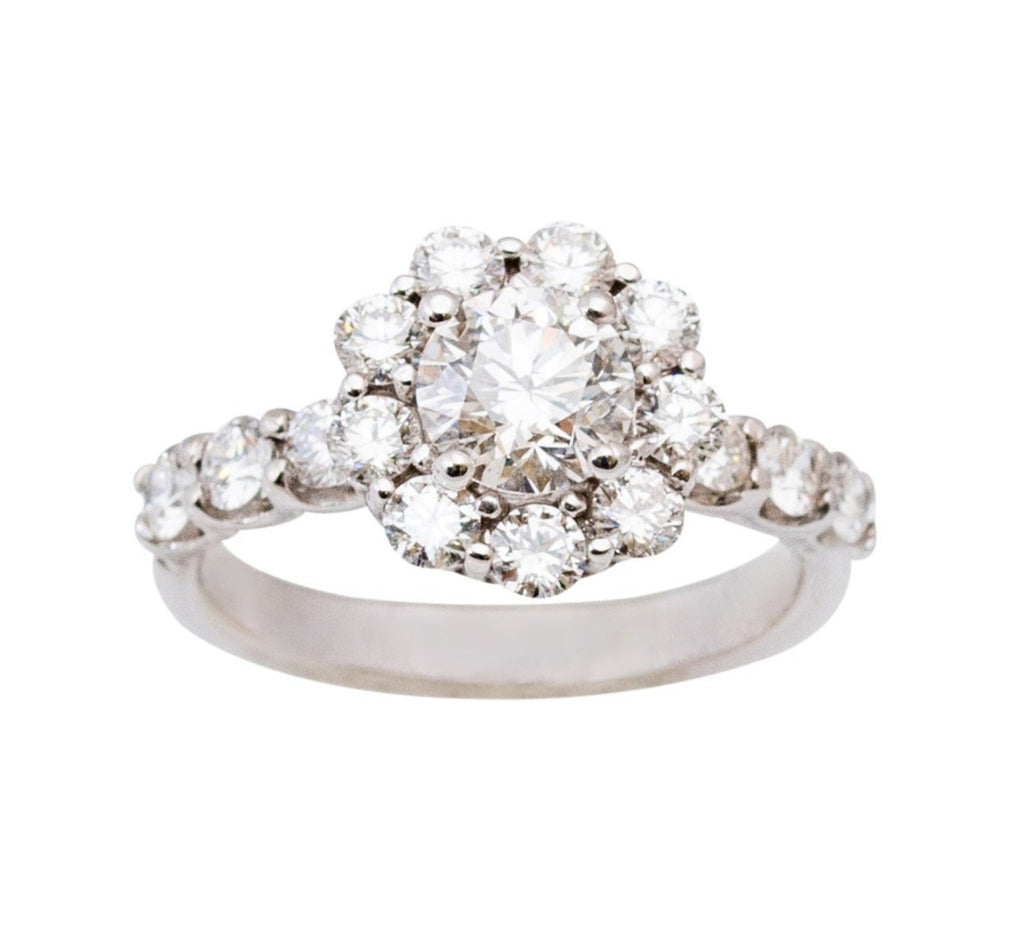One round diamond center stone 1.10 cts Clarity SI2 Color F GIA certified  Diamond halo and half way band 1.50 cts Set in 18k white gold prong setting