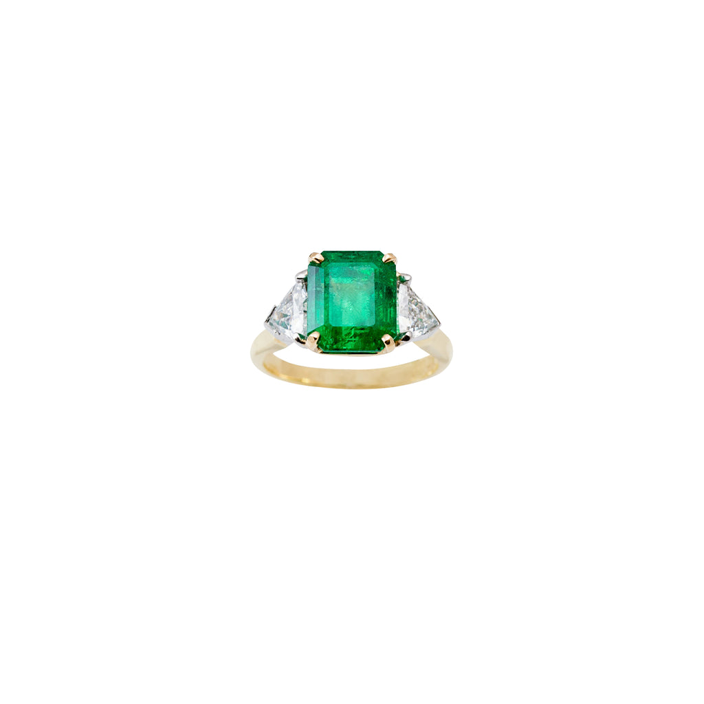 Emerald cut emerald stone 4.35 cts  Two trillion cut diamonds 18k yellow gold and platinum prong mounting  Size 6 (sizeable)