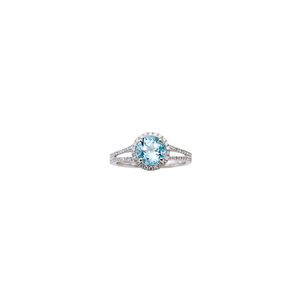 One round aquamarine 8.41 mm framed by a halo pave-set round diamonds 0.24 cts in 14k white gold double row mounting. Size 6.5 (sizable) 9.50 mm total size of the ring