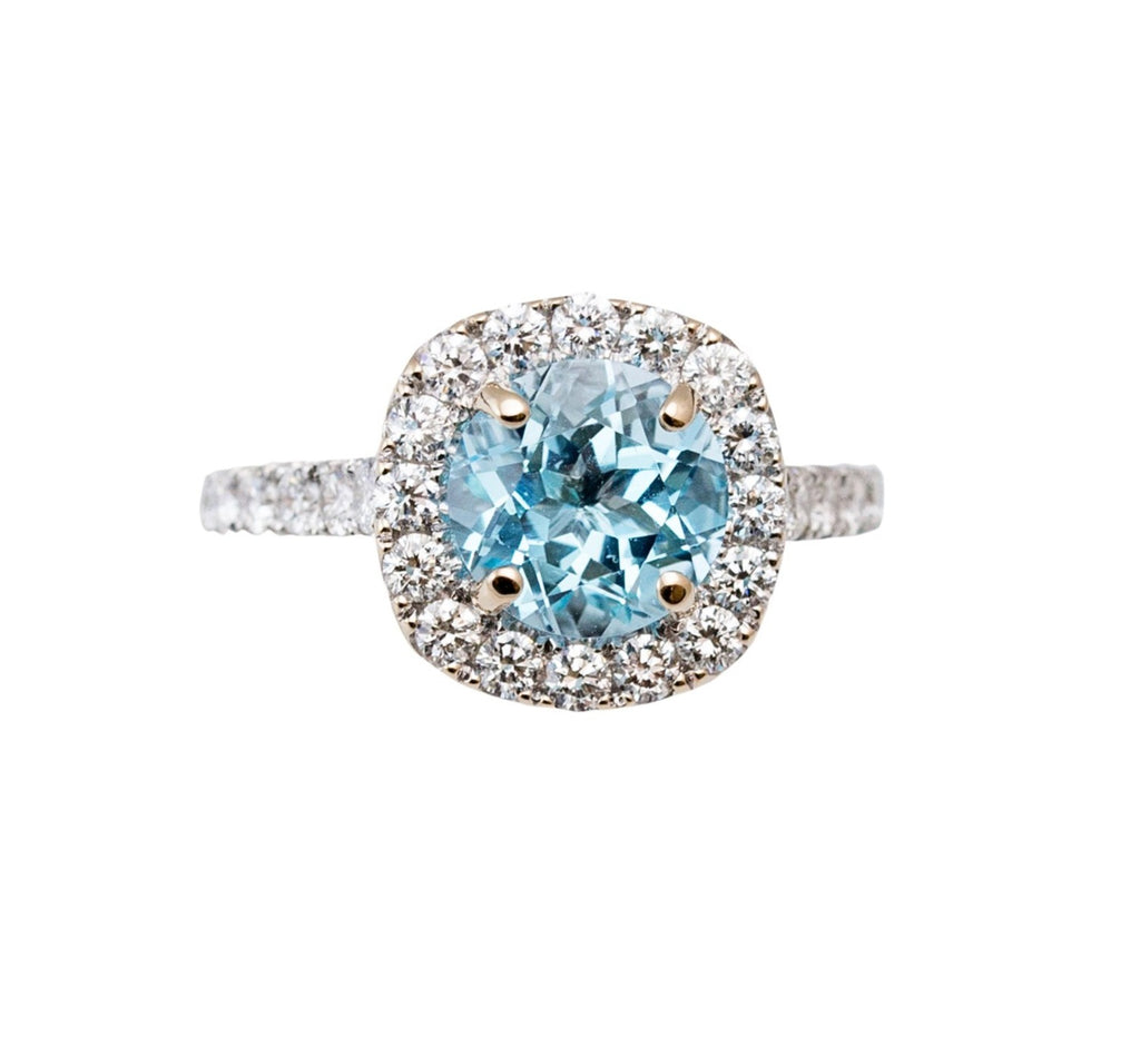 Stunning aquamarine 2.38 cts surrounded by a large diamond halo band 0.95 cts Set in 18k white gold  12.63 mm