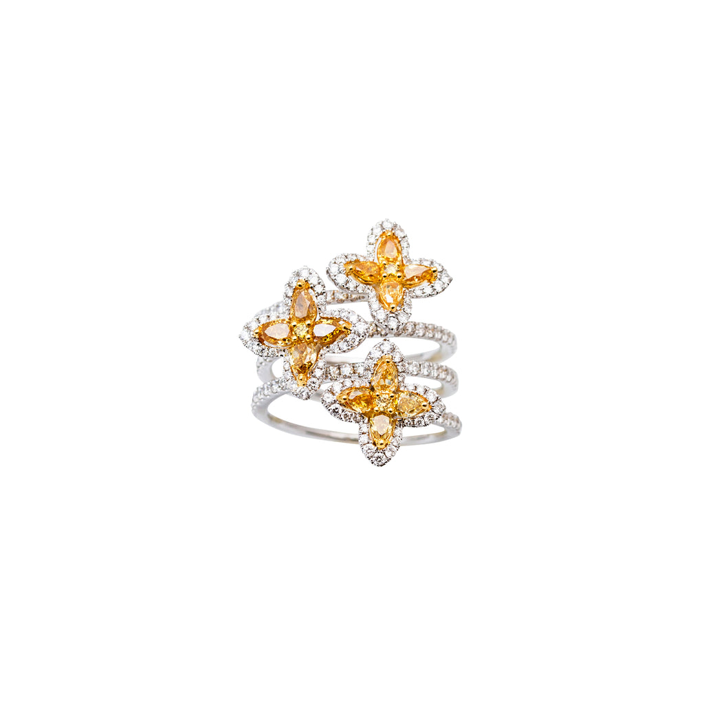 Stunning one of one a kind piece 18k white gold Three flowers set in three flexible rows  High quality diamonds: yellow & round diamonds 2.31 cts Size 6.5 (sizeable)