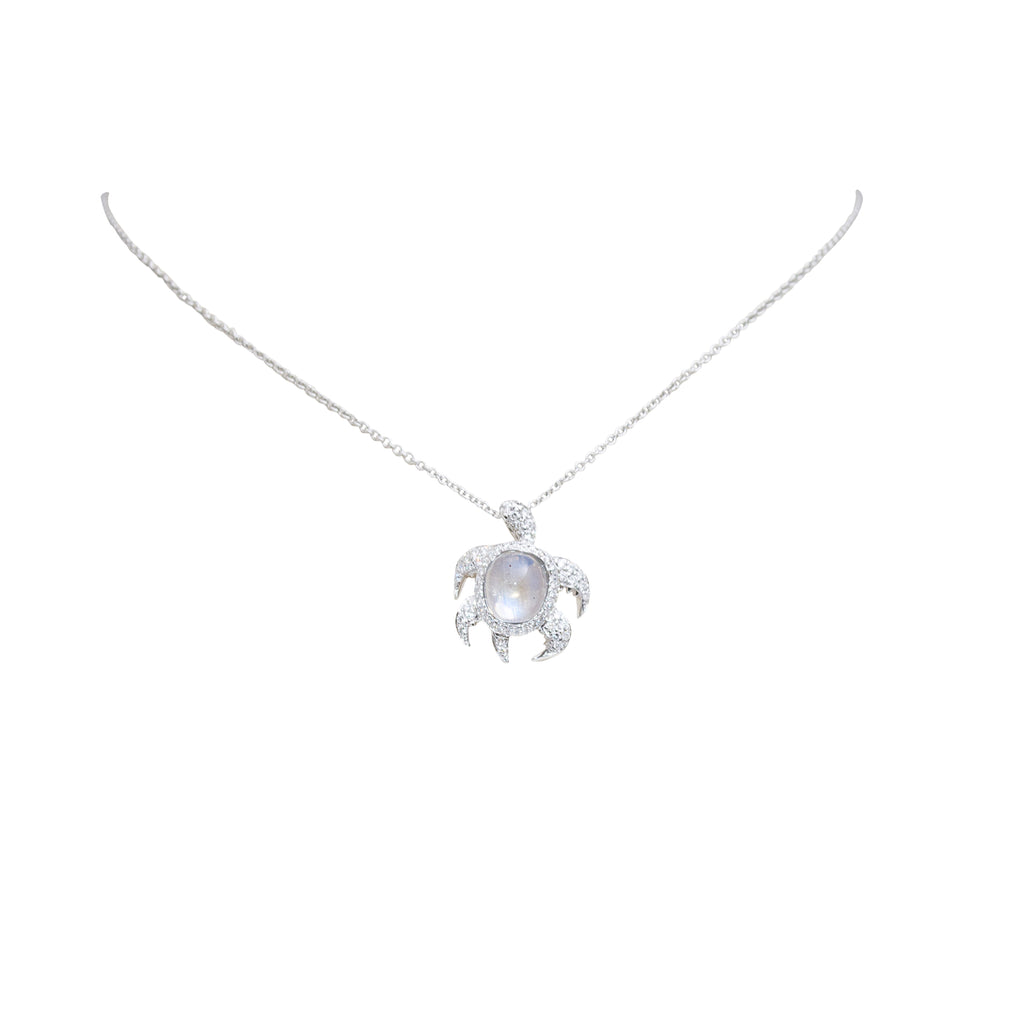18k white gold charm Turtle charm has a cabochon moonstone1.87 cts All pave diamonds 0.44 cts 19.00 mm charm size Hidden clasp Gallery finish at the back 14k white gold chain with secure lobster catch $205.00