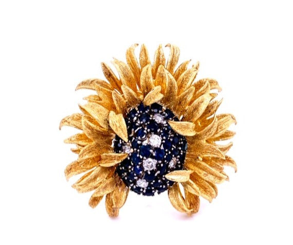 Solid 18k yellow gold  0.40 cts white round diamonds  2.00 round sapphires   E. Pearl design   Matte finish   50mm length   50 mm width   Great condition   Can be used as brooch, pin or pendant