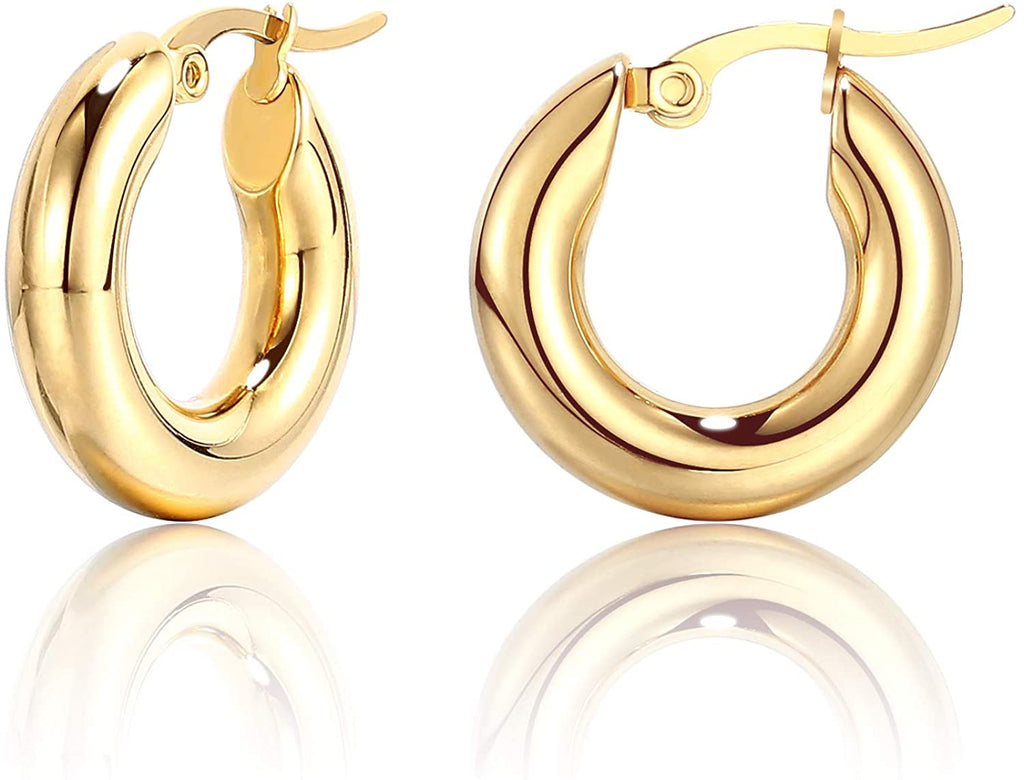 Thick hoop earrings  Set in 14 yellow gold.  Easy to wear  Secure latch system  5.50 mm thickness  20.00 mm length