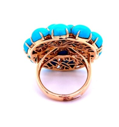 Italian handcrafted ring  Set in 18k yellow gold  Gallery design at the back   Dandelion turquoise beads  White round diamonds 0.60 cts   Size 7 (sizeable)