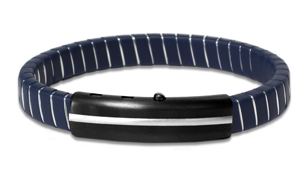 "This bracelet creates a unique style  Strip of blue synthetic rubber   Stainless steel adjustable clasp  8"" long  Rhodium copper wire"