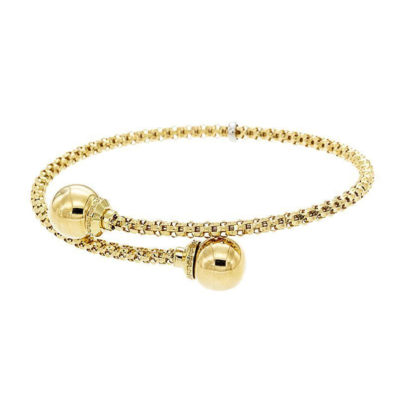 From our Stella Millano Italian collection 18k Italian yellow gold Flexible cuff One size fits all Contemporary gritty chain 3mm x 9.75 mm (each sphere)