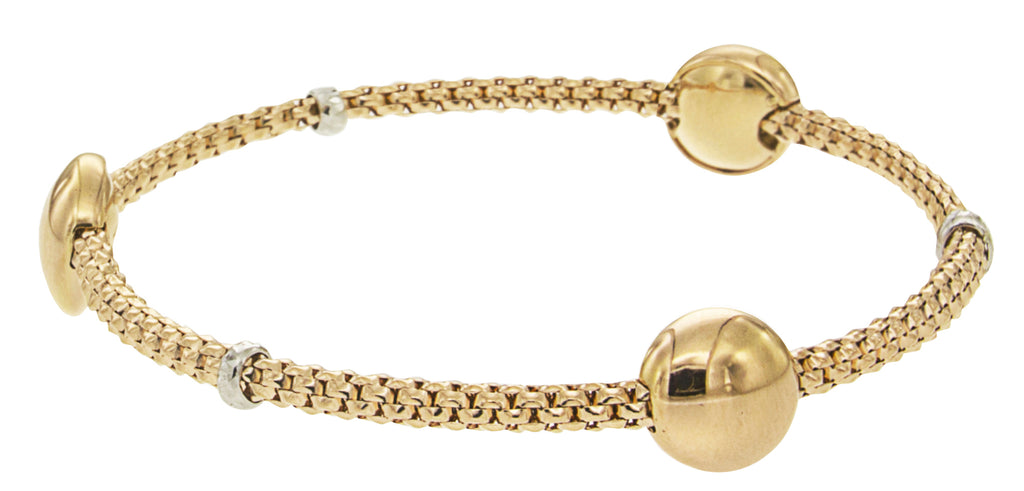 From our Stella Millano Italian Jewelry  18k Italian Yellow Gold  Flexible bracelet  One Size Fits All  Bon Bon collection  3 beads 10mm (each)  Three small rondels of 18k white gold
