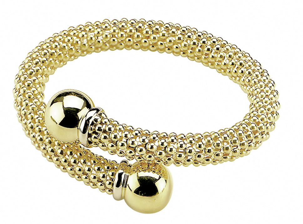From our Stella Milano Collection 18k Italian yellow gold Voluminous gold mesh that wraps the wrist like a snake Flexible cuff 8.40mm x 14.07 mm (each sphere)