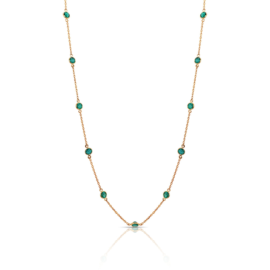 "Beautiful necklace set in 18k yellow gold.  15 emeralds.  Secure catch.  17"" long with sizing loop at 15"""