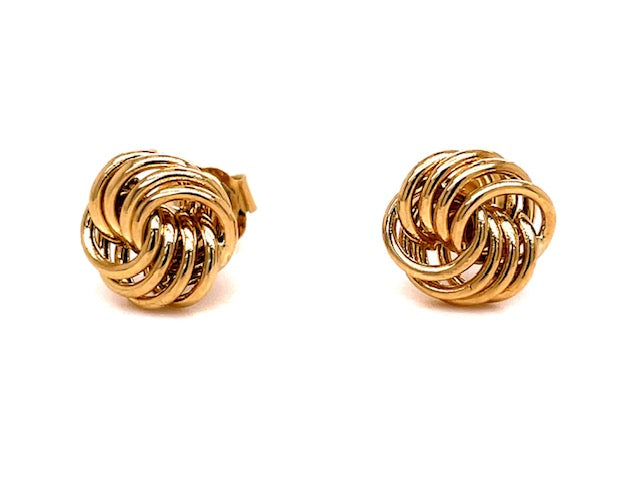 14k yellow gold.  Italian made  Secure friction back.  Love knot earrings   7.00 mm