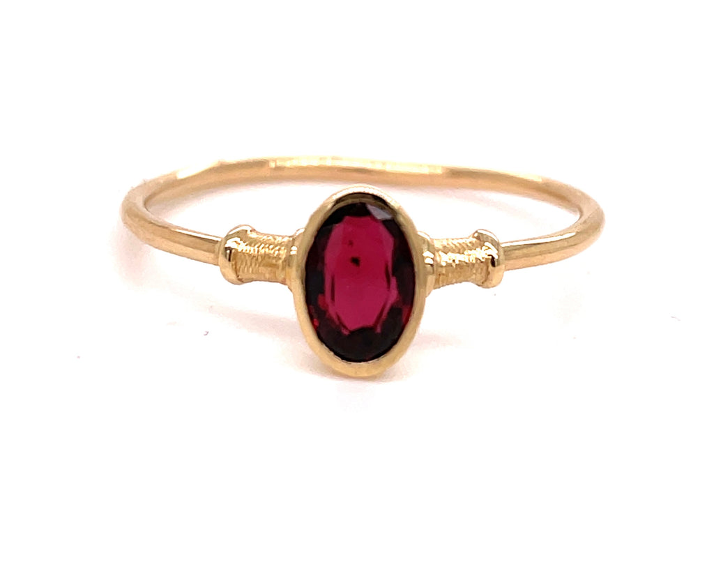 Set in 14k yellow gold.        Size 7.5  Facet oval garnet 5.45 mm