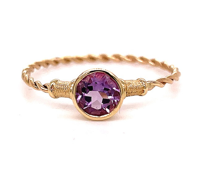 Set in 14k yellow gold.        Size 7.5  Round amethyst 4.30 mm.