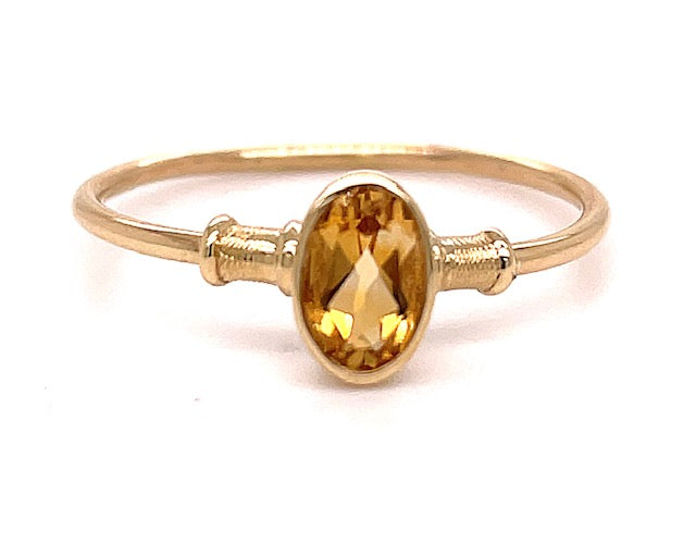 Set in 14k yellow gold.        Size 7.5  Facet oval citrine 5.45 mm