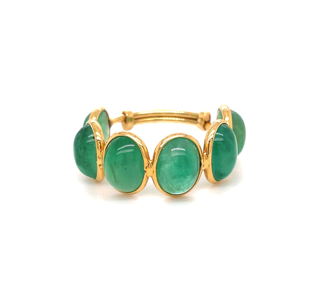 Stackable emerald ring  Set in 18k yellow gold.  Adjustable ring 6-9  Oval cabochon shape   Six large emeralds 9.00 mm x 8.50 mm size