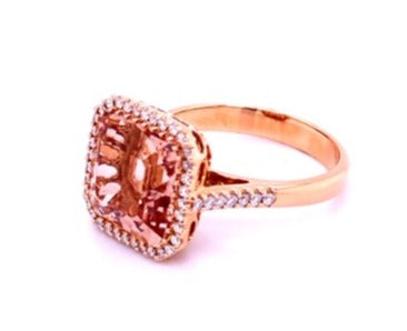 Italian made Morganite ring  Asscher cut have facets that gives you more sparkles. It gives you the illusion of a never ending depth of elegance.  Set in 18k rose gold mounting.  White round diamonds 0.24 cts creates a beautiful bezel setting.  Size 6.5 (sizeable)  15.00 mm