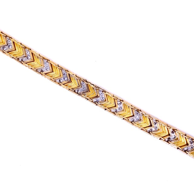 "Solid 18k yellow gold bracelet  Pave diamond chevron stations   3.40 cts round diamonds  Figure 8 secure clasp  7"" long  9.50 mm wide  Great condition"