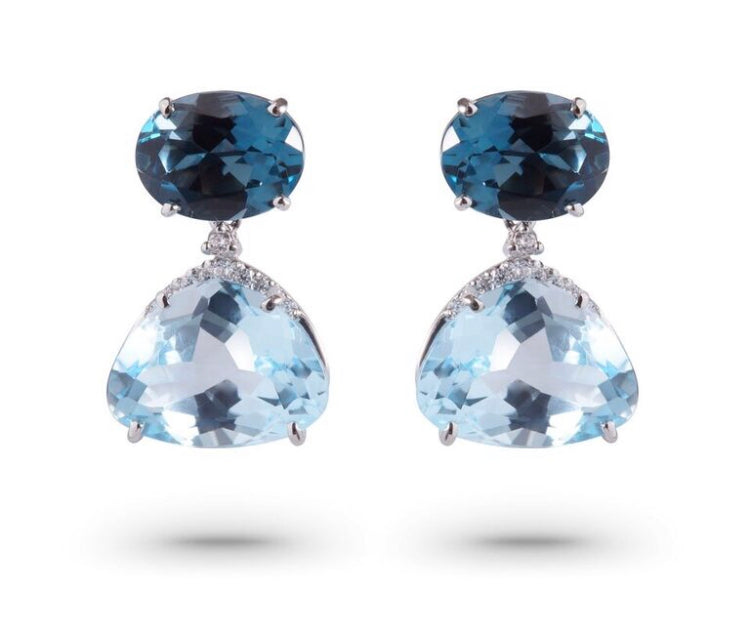 From our Vianna Brasil collection London blue topaz 12.0 cts and round diamonds 0.11 cts 19.88 mm long x 12.00 wide 18k white gold drop earrings with secure friction back