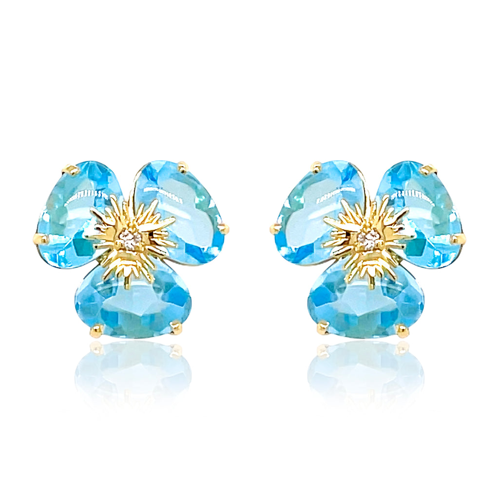 Pensée collection made in Brazil  Pensée earrings are inspired in Pansy flowers.  Blue Topaz  Two small diamonds   Set in 18k yellow gold  Secure & comfortable friction backs  12.50 mm