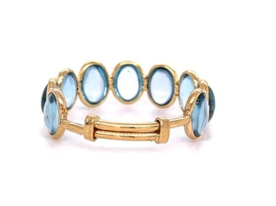 9 Oval cabochon shape blue topaz stackable ring  Set in 18k yellow gold  Adjustable shank  Size 7-9  6.20 mm each gem size