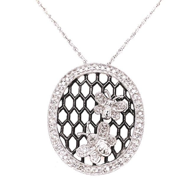 "14kt white gold  0.32 cts round diamonds   Two diamond butterflies set in a black rhodium mesh panel  Diamond circle pendant  25.00 mm long  High quality diamonds   16"" white gold chain with secure lobster catch ($205.00 optional)"