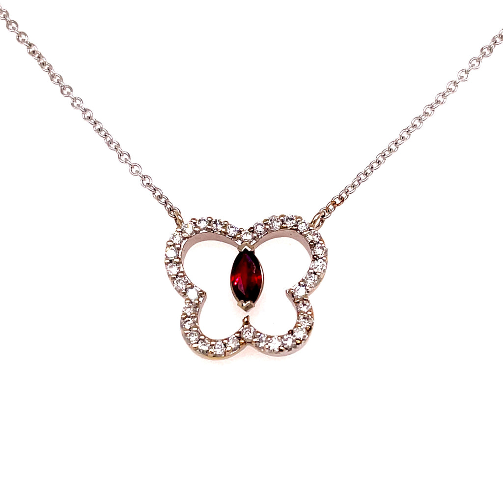 "18kt white gold  Cut out butterfly   Round diamond 0.55 cts   14.00 x 15.00 mm   15"" long chain   One oval ruby  Secure lobster catch"