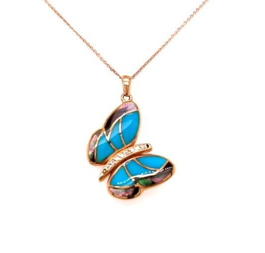 "Tilted 18kt rose gold butterfly pendant  0.05 cts round diamonds   Seamless mother of pearl & turquoise set in the wings  30.00 mm long (including secure bail)  All mother of pearl at the back (it can be used both sides)  High quality diamonds   16"" rose gold chain with secure lobster catch"