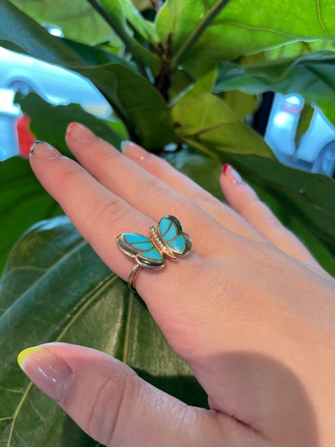 18kt rose gold butterfly ring  0.05 cts round diamonds   Seamless mother of pearl & turquoise set in the wings  15.00 mm x 20.00 mm   All mother of pearl at the back   High quality diamonds   Size 6 (sizeable)