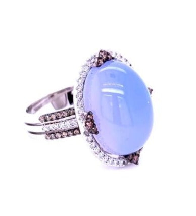 Italian made Chalcedony and diamond ring  Chalcedony cabochon 15.00 cts   Set in three row 18k white gold mounting.  White & cognac round diamonds 0.74 cts creates a beautiful bezel setting.  23.00 mm long x 218.00 mm wide  Size 6.5 (sizeable)