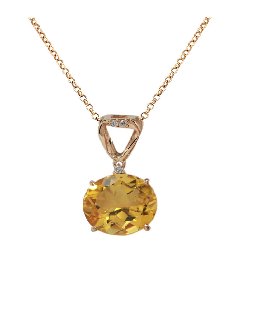 "Brazilian oval shape yellow citrine  18k yellow gold basket setting  9.00 mm wide citrine  7.00 long bail  Three small white round diamonds 0.03 cts  16"" chain $227 (optional) with secure lobster catch"