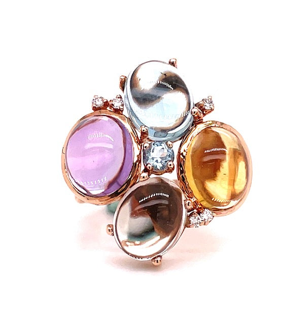 Set in 14k rose gold  4 cabochon stones; amethyst, blue topaz, citrine & moonstone   Five small round diamonds