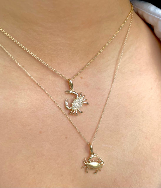 Beautiful crab pendant.  14k yellow gold.  Secure bail.  22.00 mm length.  Round diamonds 0.13 cts   1.1 mm gold chain available (optional, not included in price) $199.00
