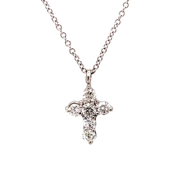 "18k white gold cross  6 round diamonds 0.30 cts.  Color E/F  Clarity VS  13.00 mm (including bail)  16"" white gold chain  optional ($160)"