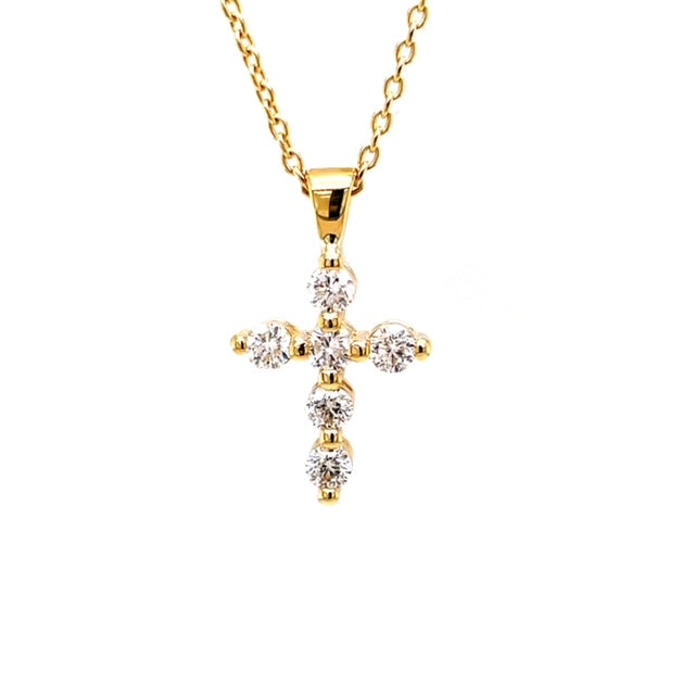 "14k yellow gold cross.  6 round diamonds  0.31 cts  Share prong setting  17'"" long including bail.   16"" yellow gold chain with secure lobster clasp"