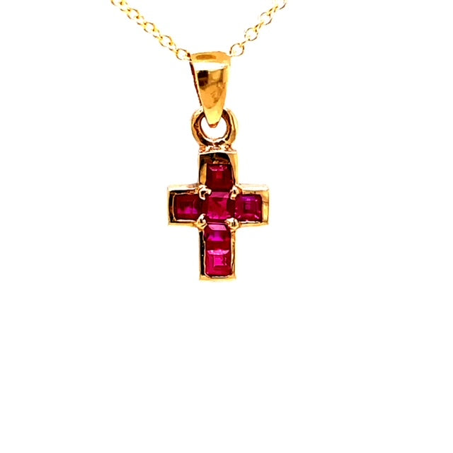 "14k yellow gold cross.  6 princess cut rubies 0.54 cts.  16.00 mm including bail. Invisible setting.  16"" yellow gold chain optional $160.00"