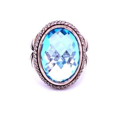 From our Estate Jewelry Section  Signed by David Yurman  Split shank sterling silver ring  Blue Topaz  White round diamonds