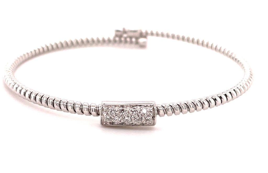 Italian designer Novecento noventanove.  Innovated tubogas technique that allows flexibility   Classic and contemporary design   18k white gold   Slip on bracelet  Round diamonds  0.10 cts.  4.60 mm wide.