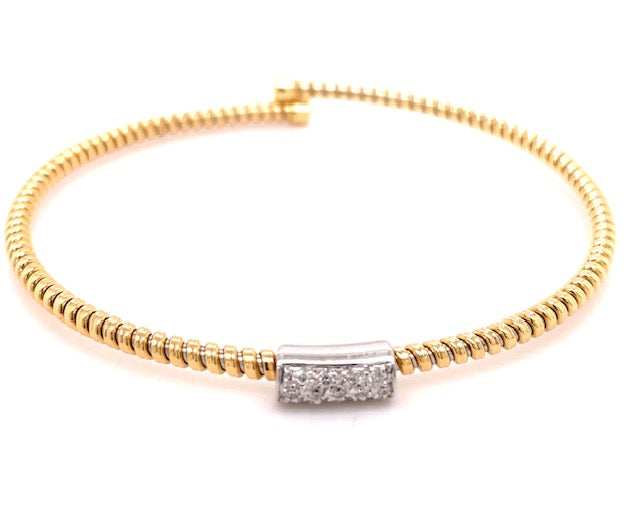 Italian designer Novecento noventanove.  Innovated tubogas technique that allows flexibility   Classic and contemporary design   18k yellow & white gold   Slip on bracelet  Round diamonds  0.10 cts.  4.60 mm wide.