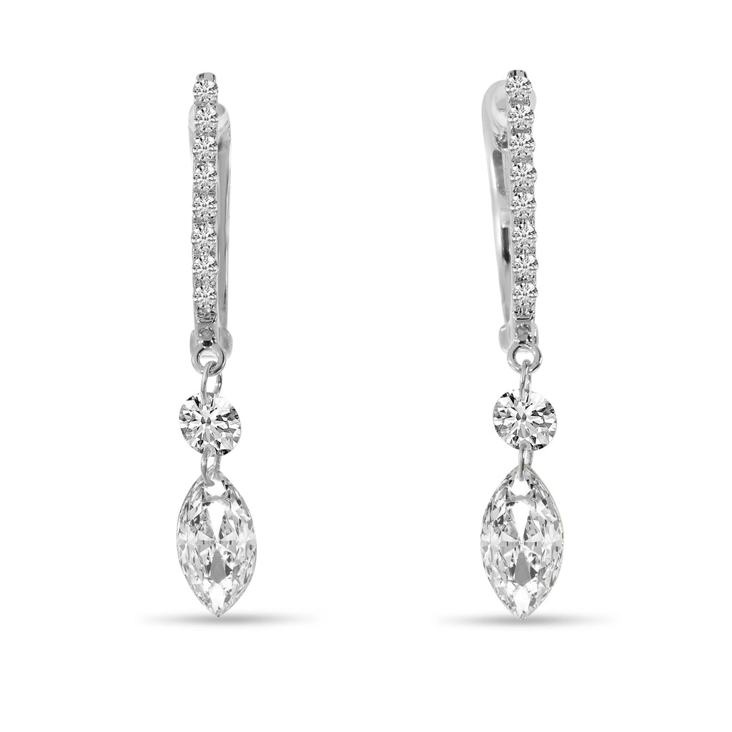 These diamonds are always floating and dancing. They are always in movement and always sparking.  Set in 14k white gold  Round graduated diamonds 1.03 cts  Lever back  28.00 mm long